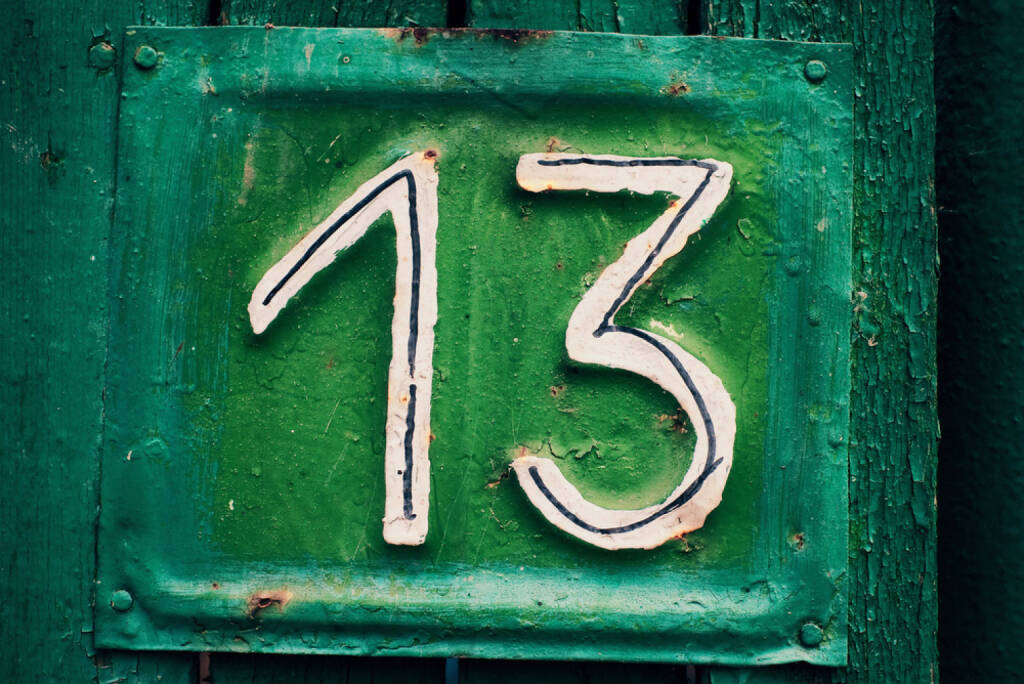 13, Dreizehn, http://www.shutterstock.com/de/pic-38275087/stock-photo-cyan-grungy-tin-house-plate-number-with-green-peeling-wooden-fence-and-selective-focus.html , © (www.shutterstock.com) (02.07.2014)